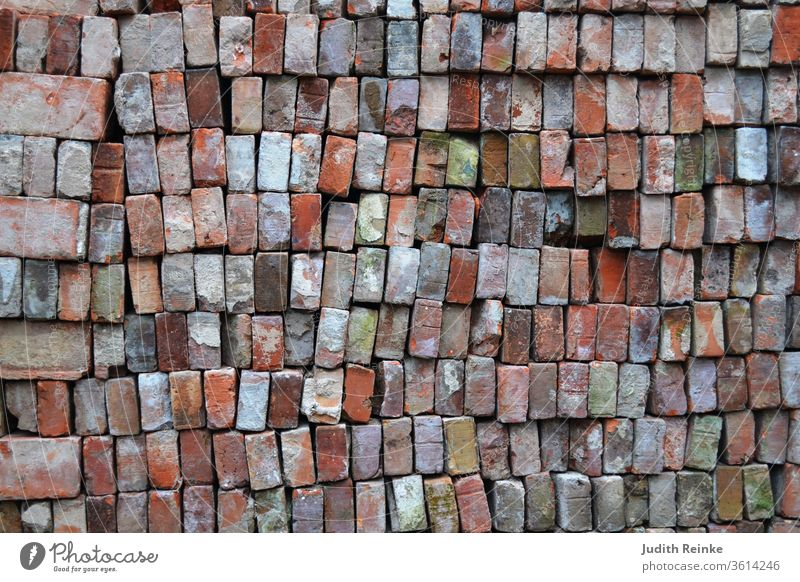 Bricks - used bricks stacked on top of each other for farmhouse restoration. Clinker bricks for North German clinker facade Northern Germany
