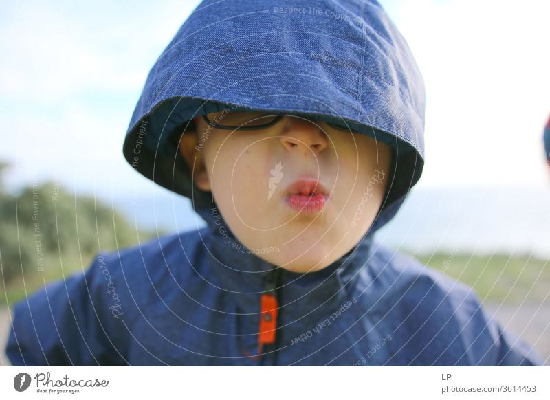 child with a hood over his eyes Hooded (clothing) Portrait photograph Looking Face Human being Facial expression Eyes Eyeglasses angry Blind Blindfold