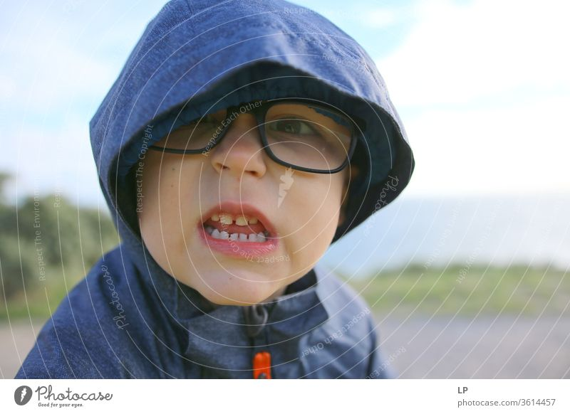 angry little boy Teeth showing Set of teeth Dentist Bite Close-up Dental care Dentistry Dangerous upset Fight Animosity Hooded (clothing) glasses Looking