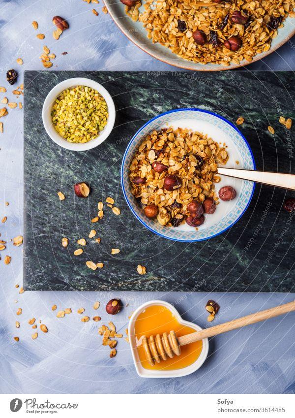 Yogurt bowl with homemade granola yogurt dairy muesli breakfast diet food healthy glass background cereal snack jar natural nutrition organic grain sweet honey