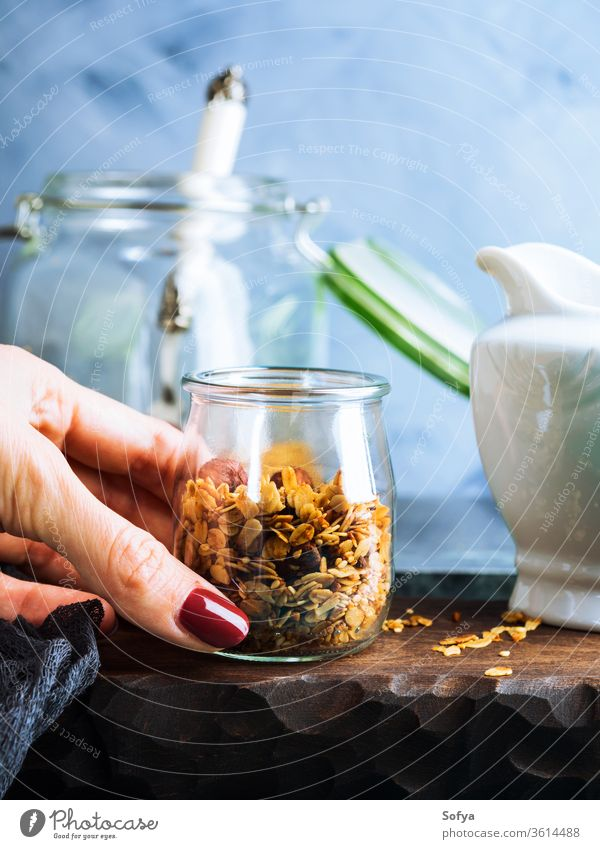 Homemade granola with honey and chestnuts homemade muesli breakfast diet food healthy glass background cereal snack blue natural nutrition organic grain sweet