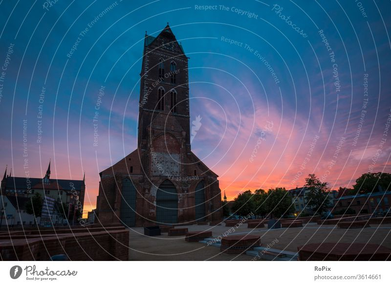 Marienkirche in Wismar in the sunset. Church Night Alley Street Old town urban Medieval times medieval Night life pavement Paving stone church sacral building