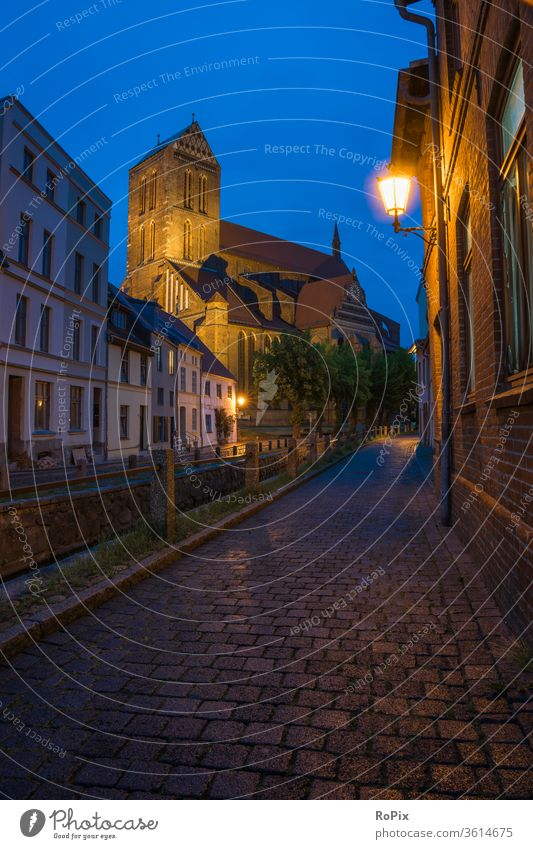 Wismar at the blue hour. Church Night Alley Street Old town urban Medieval times medieval Night life pavement Paving stone church sacral building house of God