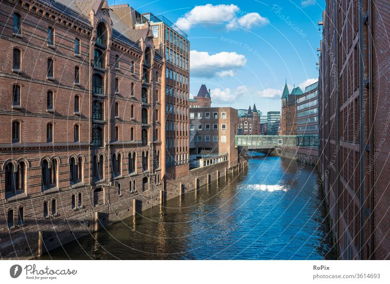 View over a canal in the hamburg warehouse district. storehouse city Harbour Depot Channel urban Hamburg Elbe bridge built Architecture River Light Low tide