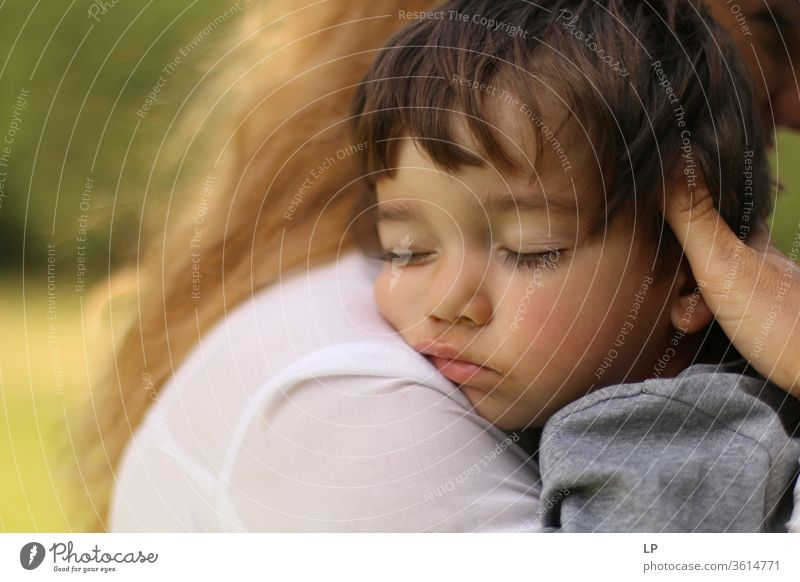 baby sleeping in mothers's arms Sleep Sleeping place Safety Safety (feeling of) Rest Relaxation Dream Child Baby Infancy real people hug Closed eyes Front view