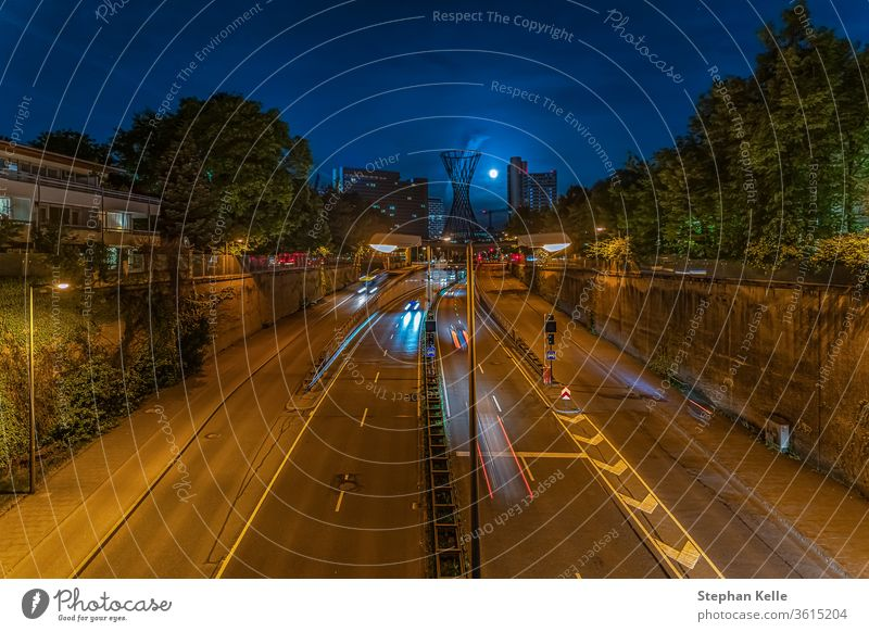 Modern architecture. A night in Munich with driving cars and light trails in the center of the bavarian capital at the Effnerplatz. drive abstract traffic city