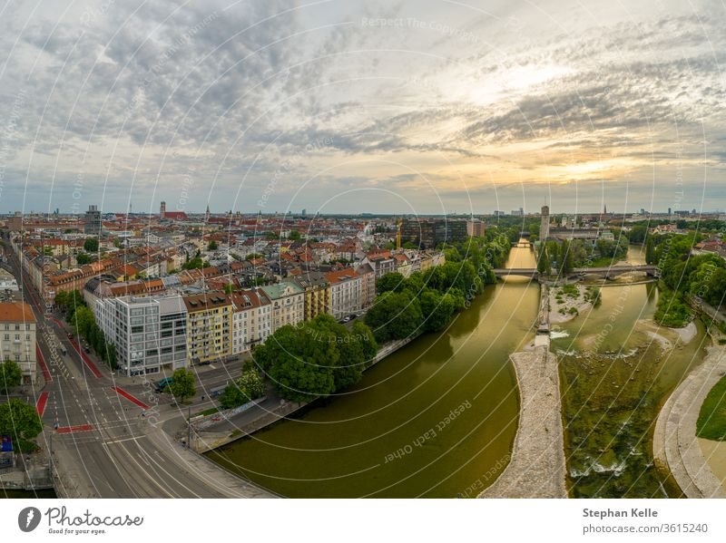 Munich view from a drone at the sunrise includes the Isar river and some popular landmarks minga aerial copter isar munich center junction landscape mountains