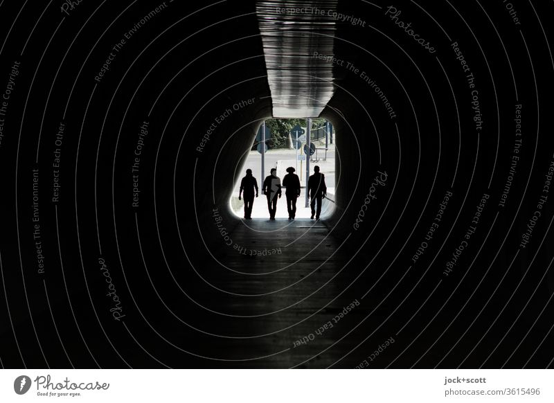 four figures enter, into the great darkness Tunnel Back-light Silhouette Lanes & trails Passage Dark Pedestrian Low-key Tunnel vision Going Symmetry Identity