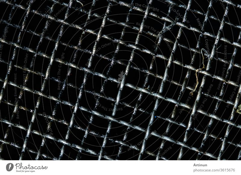 Dirty grille for filter and collect used motor oil in car or motorcycle. Black oil  or automotive fluids stains on grille. Recycling used motor oil reused as fuel oil for help environment. Carcinogens