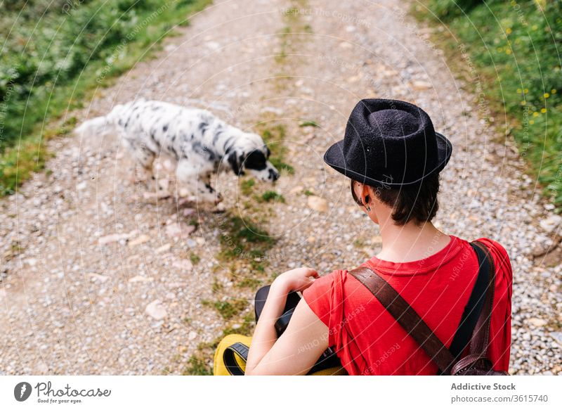 Informal female photographer with dog on rural road countryside woman photo camera english setter informal style asturias spain photography pet nature backpack