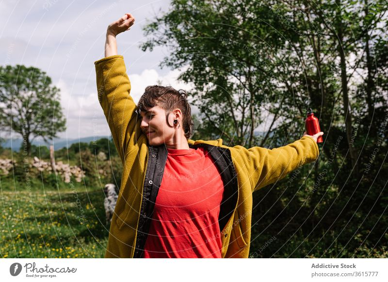 Carefree woman enjoying summer during vacation traveler meadow freedom carefree content tourism landscape nature informal female asturias spain rest relax