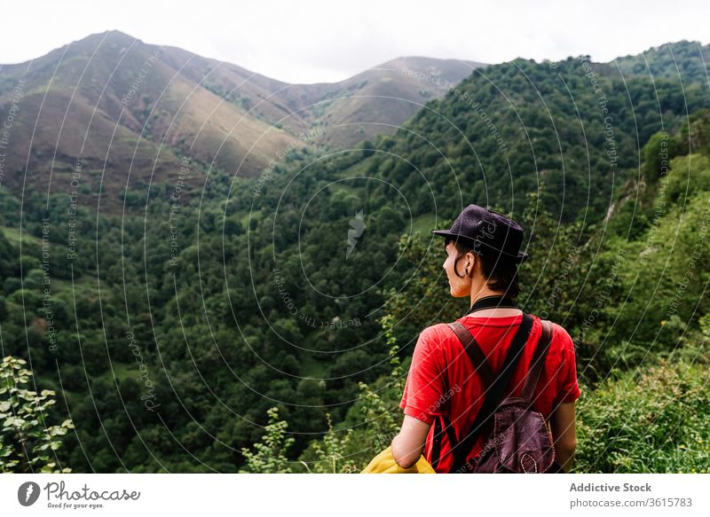 Calm female traveler enjoying natural landscape mountain woman tourist admire calm valley countryside amazing asturias spain freedom adventure rest relax scenic