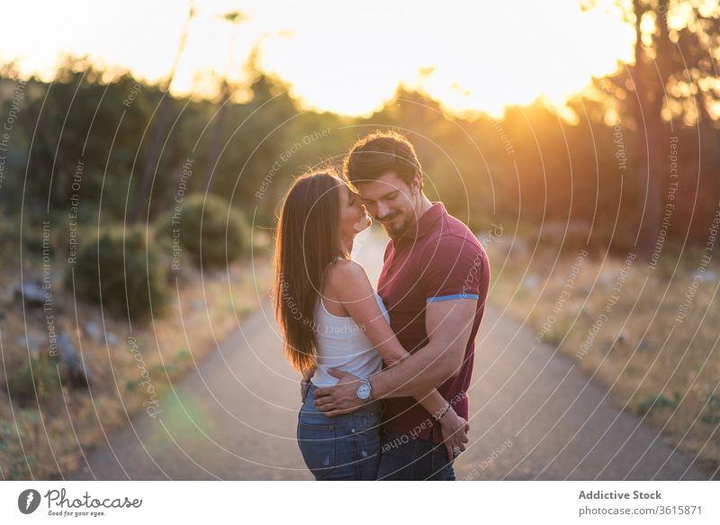 Loving couple embracing in park tender embrace sunny together love happy smile relationship romantic garden hug affection summer date close romance enjoy