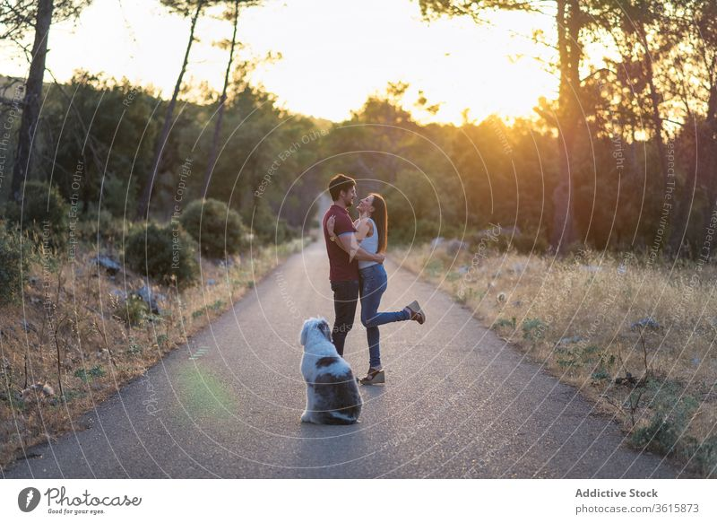 Tranquil happy couple on road with dog tranquil sunset harmony together unity relax stand amazing girlfriend boyfriend roadway old english sheepdog enjoy