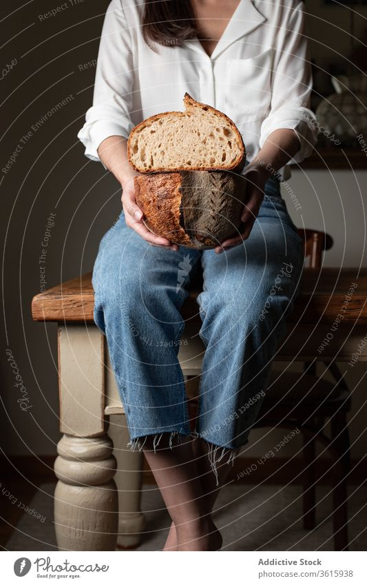 Crop woman with fresh bread delicious baked kitchen bakery table loaf nutrition female homemade pastry food tradition sit wooden meal tasty gourmet lady healthy