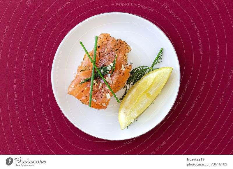 Norwegian smoked salmon canapes with lemon, blue cheese sauce, pepper and salt from above snack food norwegian food meal appetizer bread fish olive oil cuisine