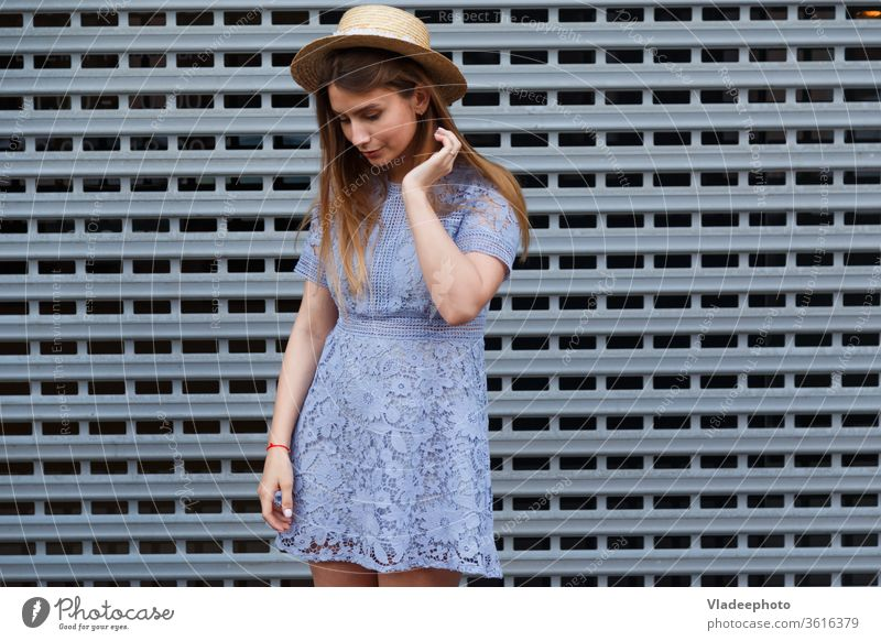 Portrait of a beautiful graceful woman in elegant hat and blue lace dress. Beauty, fashion concept summer young girl model female beauty lady attractive