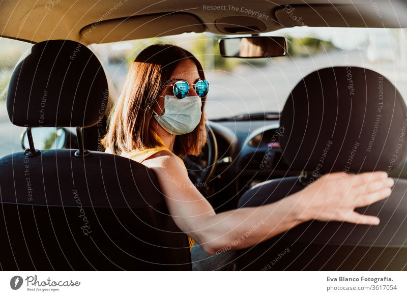 young woman in wearing protective mask. Summer season. prevention corona virus concept car pandemic covid driving driver travel summer sunset trip adult breath