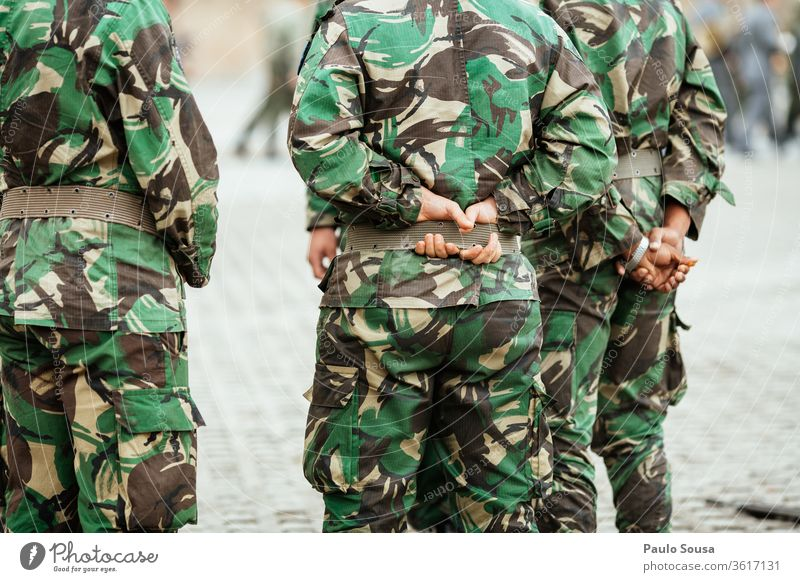 Rear view soldiers Military Soldier Army gun Man armed carbine military army Uniform Camouflage Federal armed forces commando Rifle ammunition Weapon War