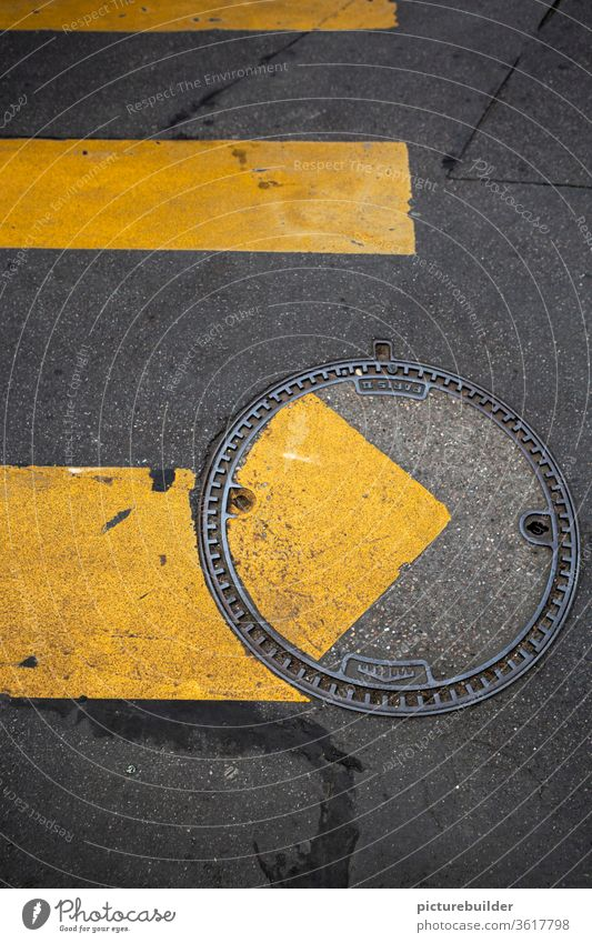 Zebra crossing and manhole cover Street Manhole cover Road marking attentiveness incorrect road surface Yellow Gray Offset Bird's-eye view Asphalt Metal