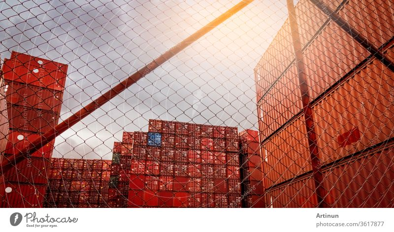 View from fence of red container stacked. Container logistics. Cargo and shipping. Import and export logistics business. Container freight station. Logistic industry. Container for truck transport.
