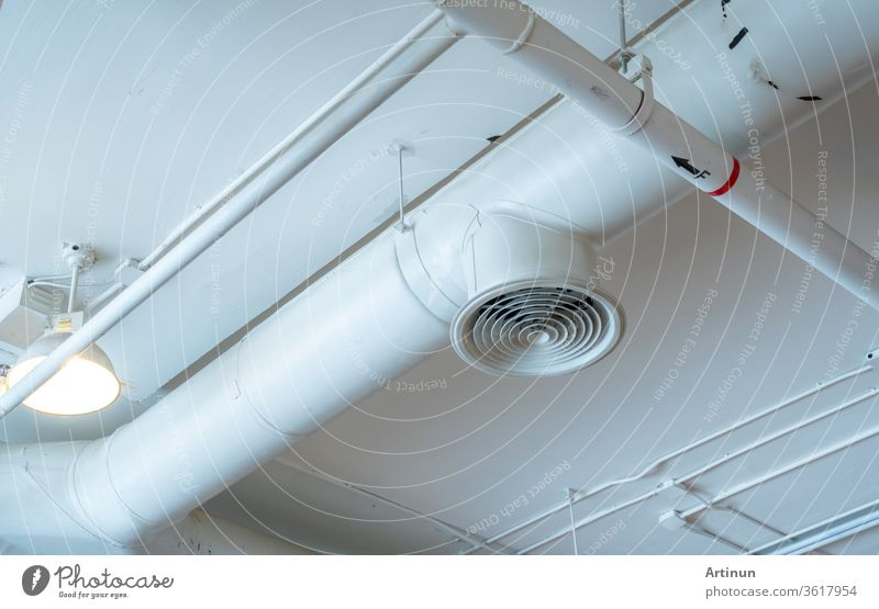 Air duct, wiring and plumbing in the mall. Air conditioner pipe, wiring pipe, and plumbing pipe system. Building interior concept. abstract aeration air