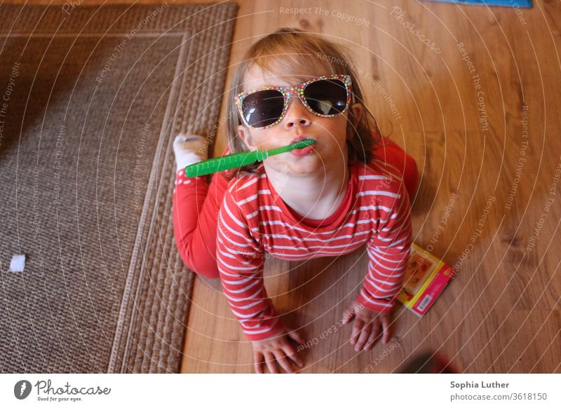Toddler brushes teeth with sunglasses Child Infancy Childhood memory girl Playing Parenting Joy 1 - 3 years Boy (child) Sunglasses Brushing your teeth