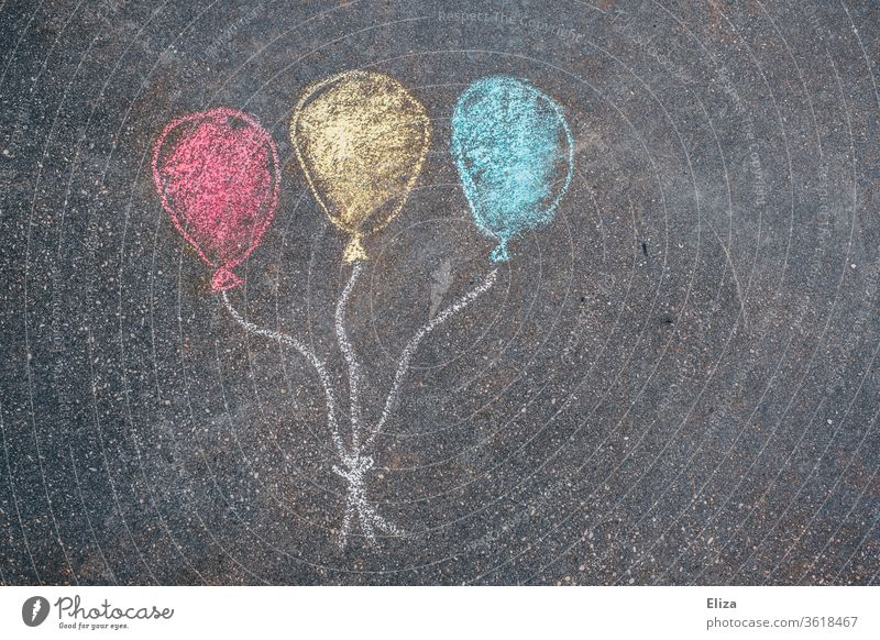 Three colorful balloons painted with chalk on the street. Birthday. Party. Chalk street-painting chalk Childrens birthsday Surprise Street Birthday invitation
