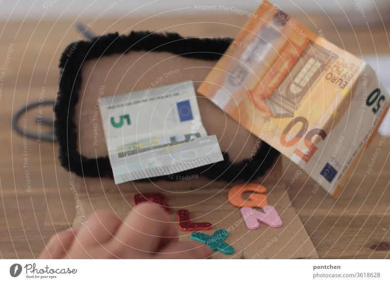 Online banking. Earn money from your computer. Banknotes 5 euros and 50 euros come out of a computer screen. Money Bank note Luxury bank account Economy