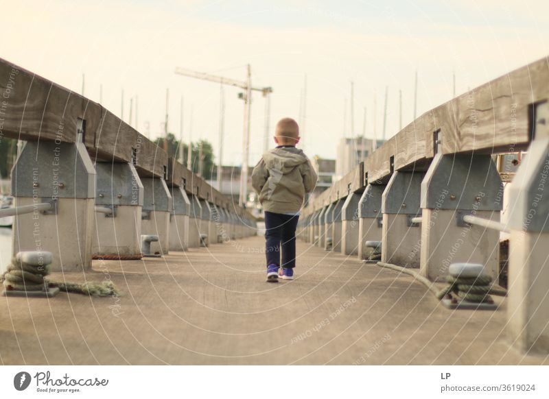 boy walking on a bridge Bridge way Dream Posture Considerate Peace Nature Calm Exterior shot Freedom tranquil Emotions Expression Sadness Loneliness Remote