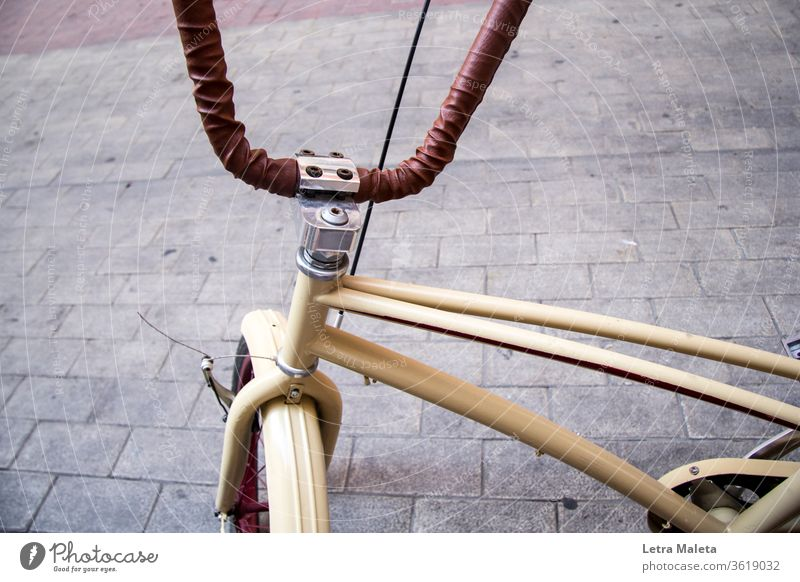 Brown urban bike in the city brown bike brown bicycle urban bicycle Bicycle biking transportation ride wheel cycling Cycling Lifestyle Exterior shot street