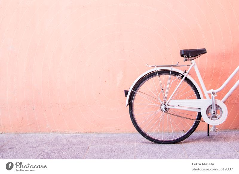 Urban white bike in an orange wall urban White vintage vintage bicycle urban bicycle urban bike white bicycle street street bike wheels Transport biking cycling