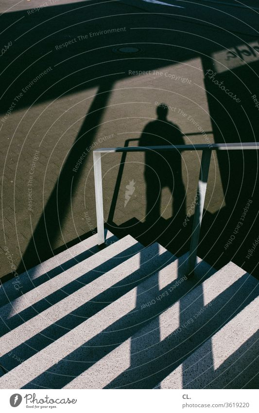 stairs and shadow of a person Stairs stagger Handrail Banister Man Architecture great Downward Sharp-edged Anonymous Shadow Exterior shot