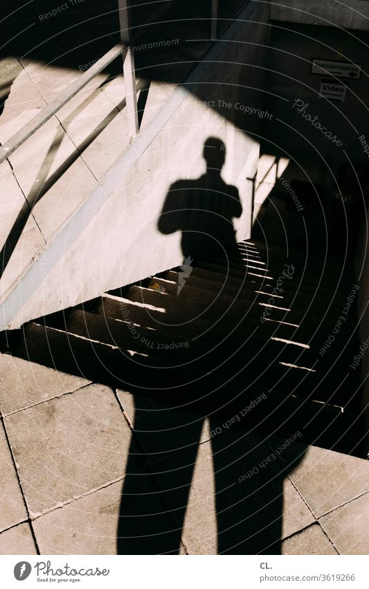 the shadow of the photographer Shadow Shadow play person Man Stairs Architecture Structures and shapes Human being Downward Ground