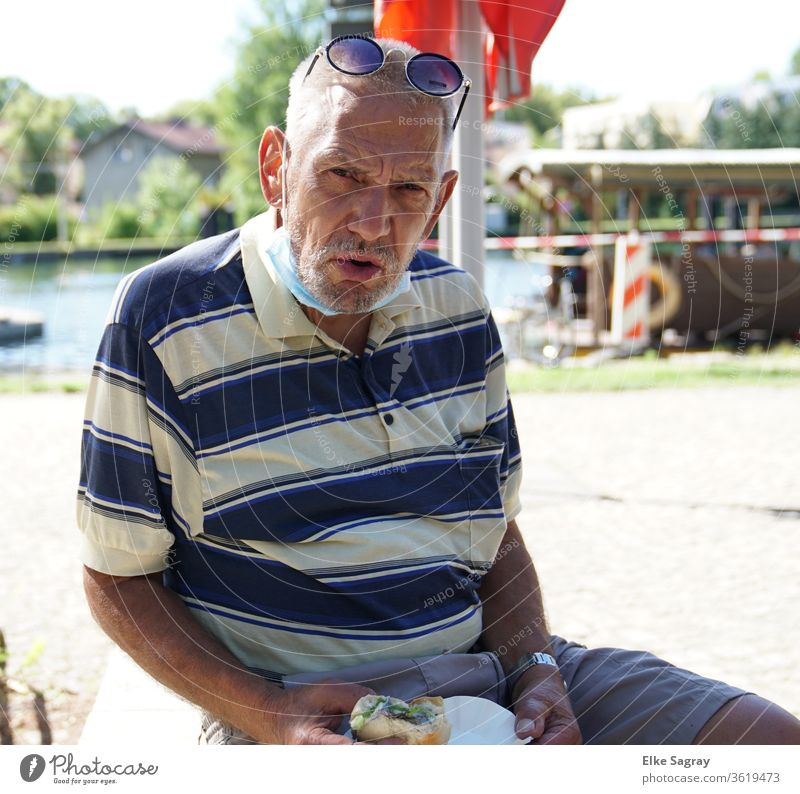 People among us - Willy Senior citizen Grandfather Man with fish roll 60 years and older Exterior shot Adults Human being Masculine