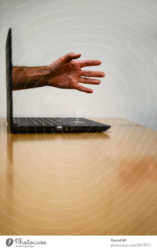 Hand breaks through the screen Screen break through laptop Addiction Intrusive Computer Online reality Virtual Internet Technology