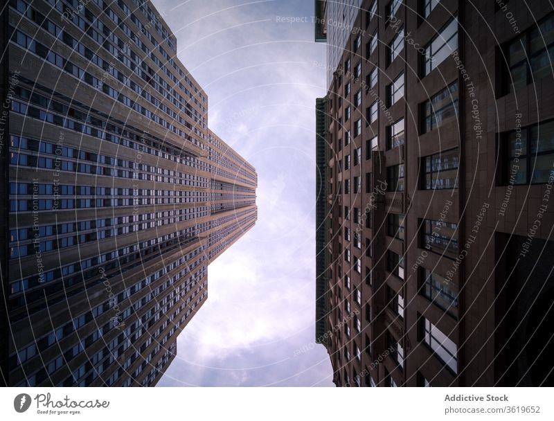 Urban skyscrapers under blue cloudy sky building city tower modern skyline design exterior contemporary architecture high rise new york usa urban downtown