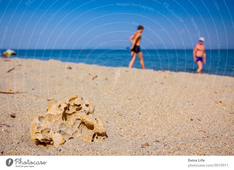 A hollow stone on a sandy shore Abstract Aged Backdrop Beach Blue Coast Coastline Colorful Cracked Golden Gravel Ground Hole Holiday Hollow Horizon Idyllic