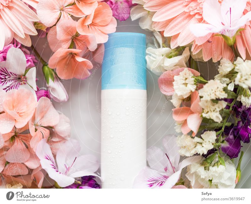 Face moisturizer in water with flowers face lotion product skin care pump dispenser beauty bottle facial pink spring hydration moisture background petal white
