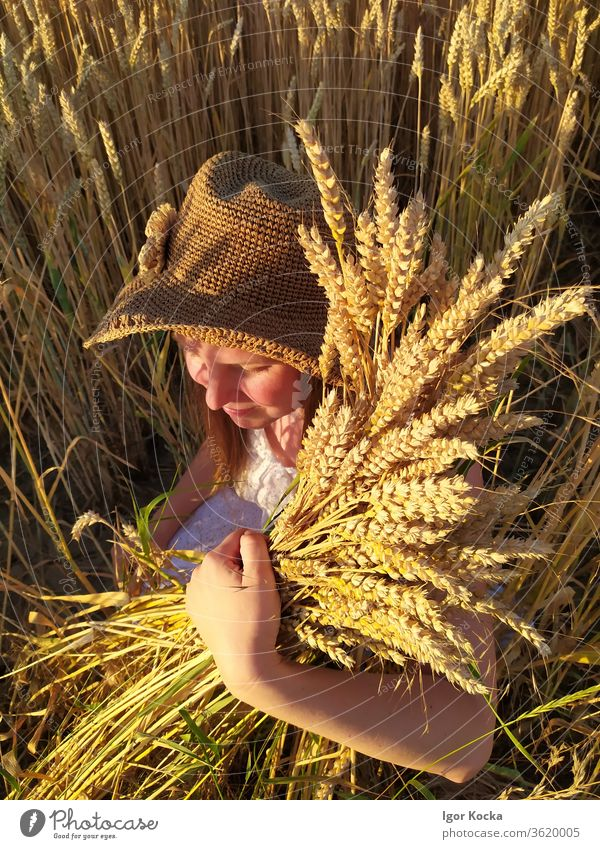 Portrait Of Woman Wearing Hat And Holding Wheat adult woman wheat hat holding Smiling Growth Happiness Exterior shot Agricultural crop Colour photo Field Summer