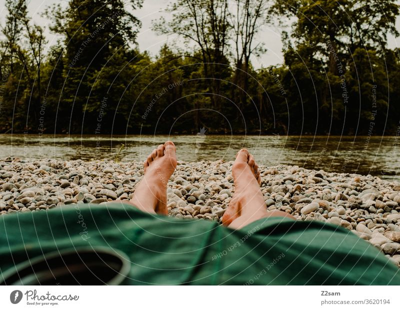 Recreation on the Isar Relaxation River Water vacation Lie Legs short Man chill Summer Exterior shot Vacation & Travel Human being Nature Colour photo Lifestyle