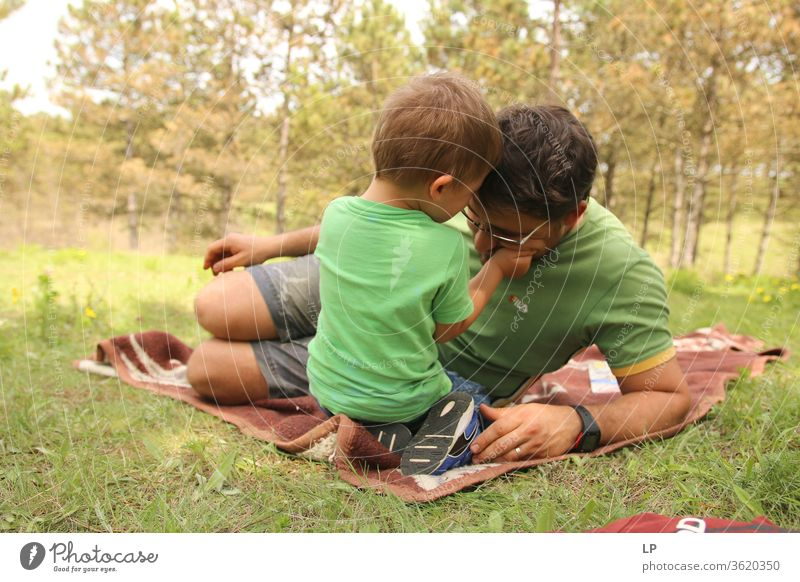 child holding father's head Parenting parenthood Parental care Parent with child parental leave Adults Parents Education Love Affection Child Family & Relations