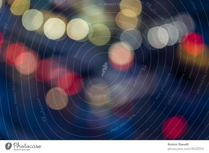 colorful bokeh of a blurred street for backgrounds light night cars lights abstract glitter silver sparkle holiday bright texture pattern decoration festive