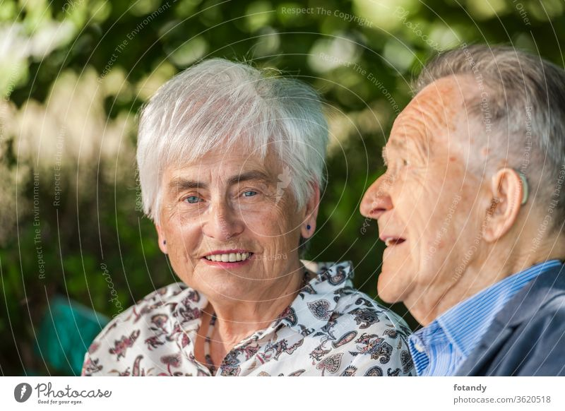 Head portrait of a retired couple Person Luck married Relationship Park Grandparents Feelings charming Partner close 2 attractive smiling Togetherness