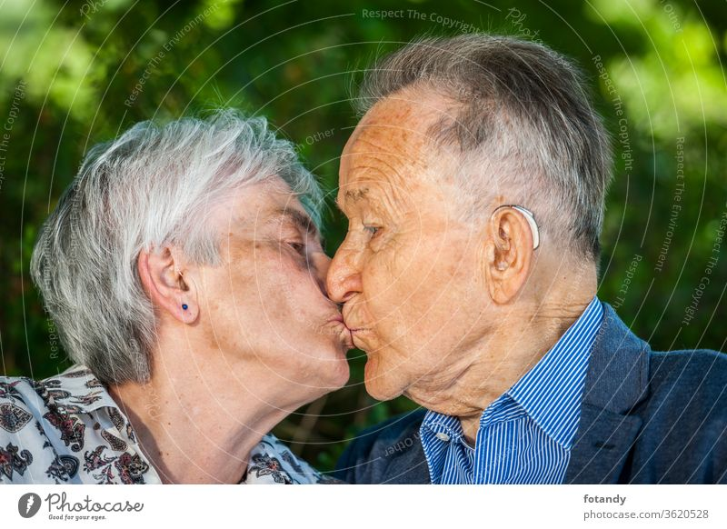Seniors in love with a kiss Person Luck Kiss married Intimacy touch Tenderness Relationship Park Partner Closeness across from Trust People happy ripe