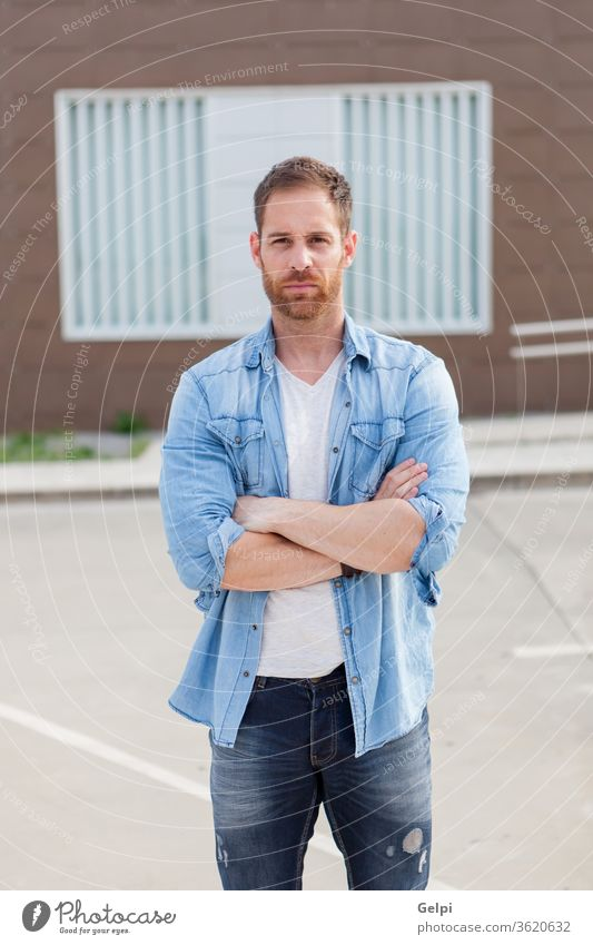 Casual guy with a denim shirt relaxed male young handsome casual man model beard fashion portrait attractive people adult person building confident style street