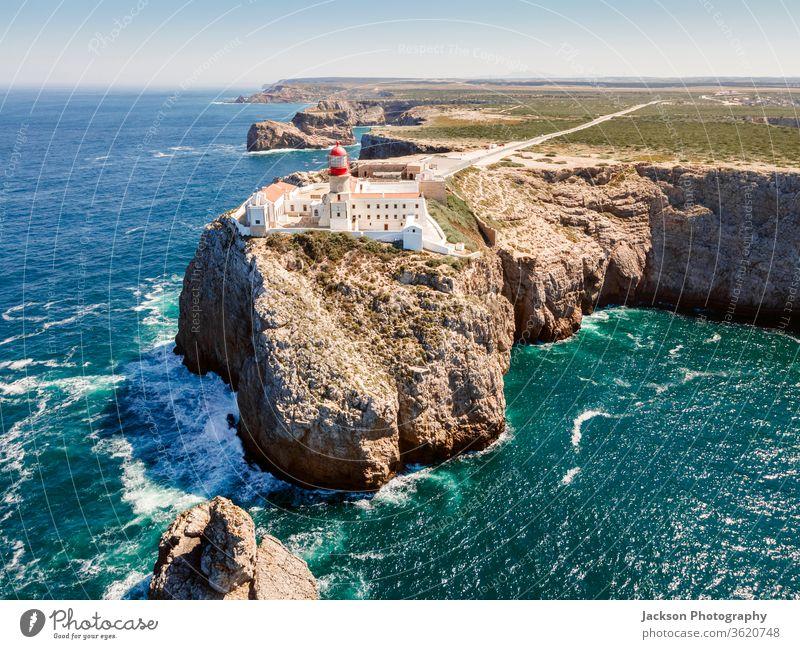 Beautiful lighthouse located on high cliffs of Saint Vincent cape in Algarve, Portugal sagres algarve portugal cabo de sao vicente ocean farol point western