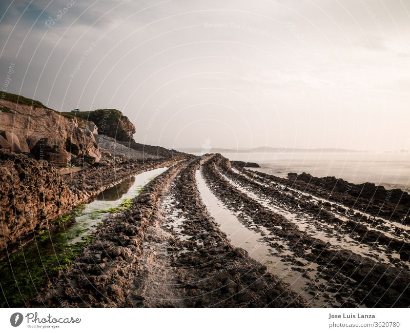 Water paths between the rocks on the rocky beach, Spain. nobody color image scenic houses europe copy space blue sky white beach lodges shore photography