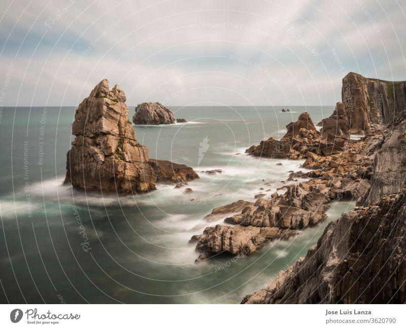 Seascape of rocky cliffs at the edge of the sea sky coastline scenic nature landscape ocean water seascape travel sunset grass landmark famous beach erosion
