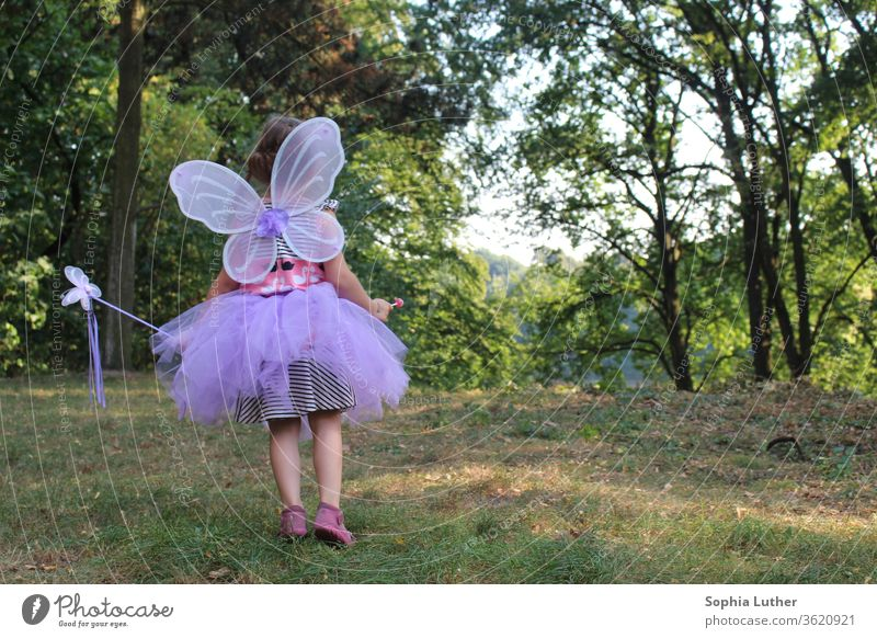girl in fairy costume / disguised girl child fairy Girlish Fairy fairylike Child Exterior shot Infancy Colour photo Feminine already clearing Dress tutu Looking